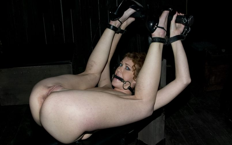 Gagged woman is in bondage and her pussy is ready for painful tortures