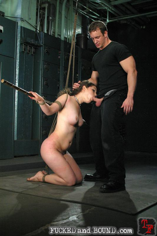 Image of tied girl Charlotte Vale sucking cock in bondage