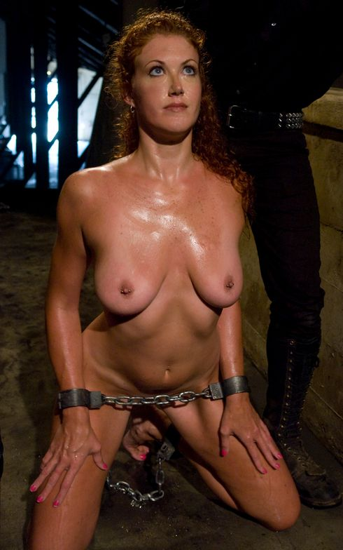 Image of slave Sabrina Fox chained and pocing on her knees