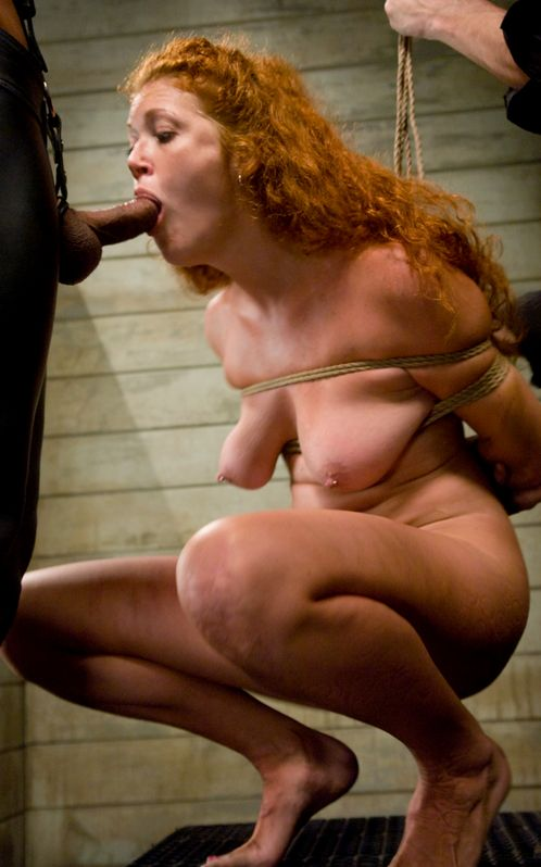 Picture of tied girl Sabrina Fox sucking cock. Forced bondage blowjob