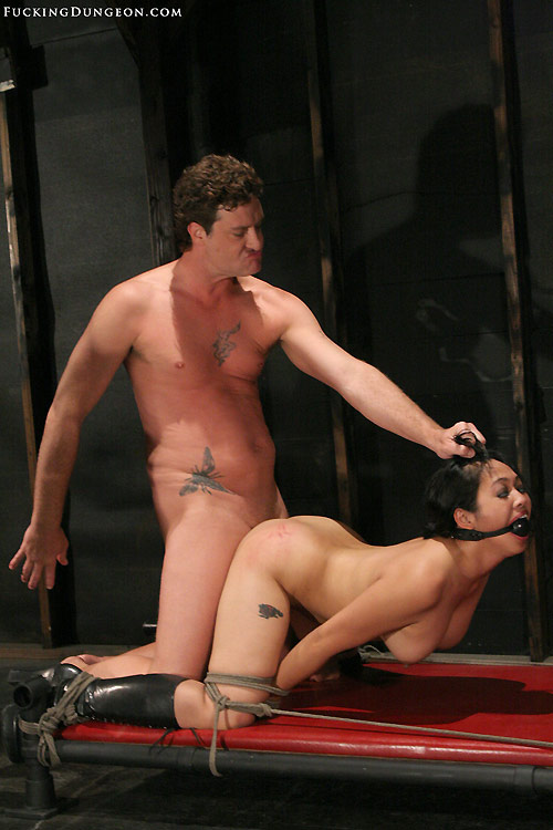 Image of helplessly bound slave Mika Tan fucked in her ass