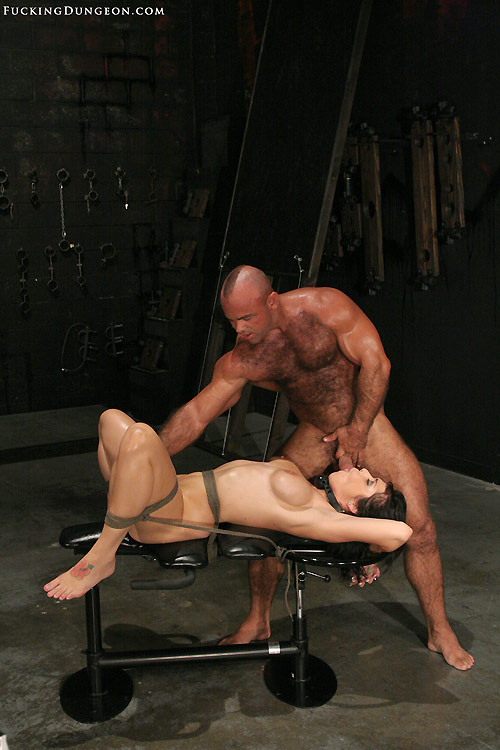 Photo of helpless bondage slave Beverly Hills forced to suck cock. Bondage oral sex