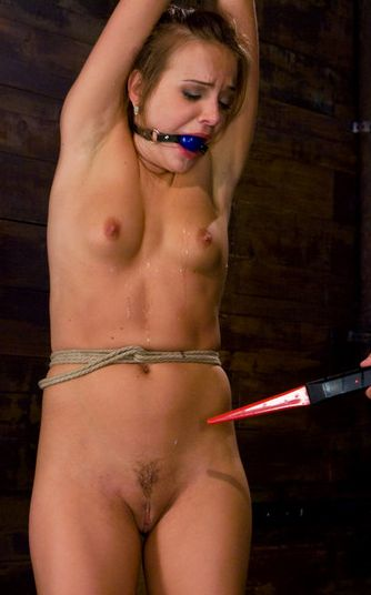 Photo of Nika Noire tied up and tortured with electricity