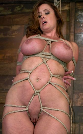 Photo of nude slave Christina Carter posing in tight rope bondage