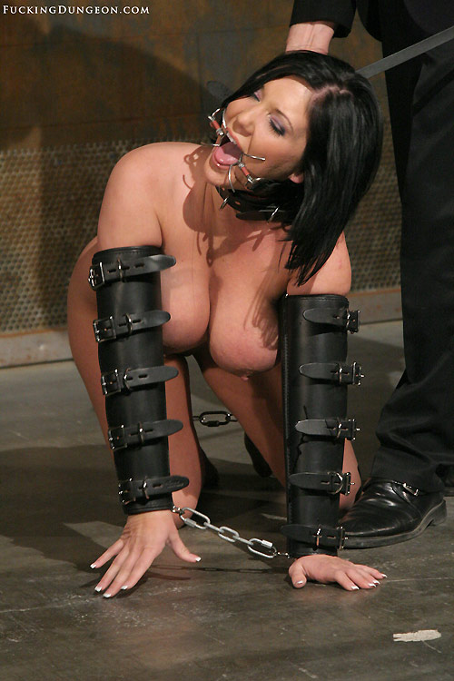 Photo of submissive slave Clair Dames crawling on her knees