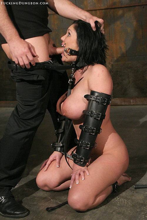Picture of exposed bondage slave Clair Dames sucking cock