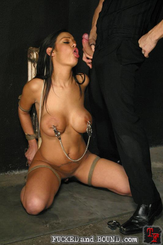 Image of busty Angelina Valentine in bondage and sucking cock