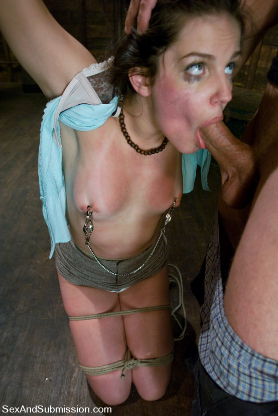 Picture of a bondage slave Bobbi Starr sucking cock