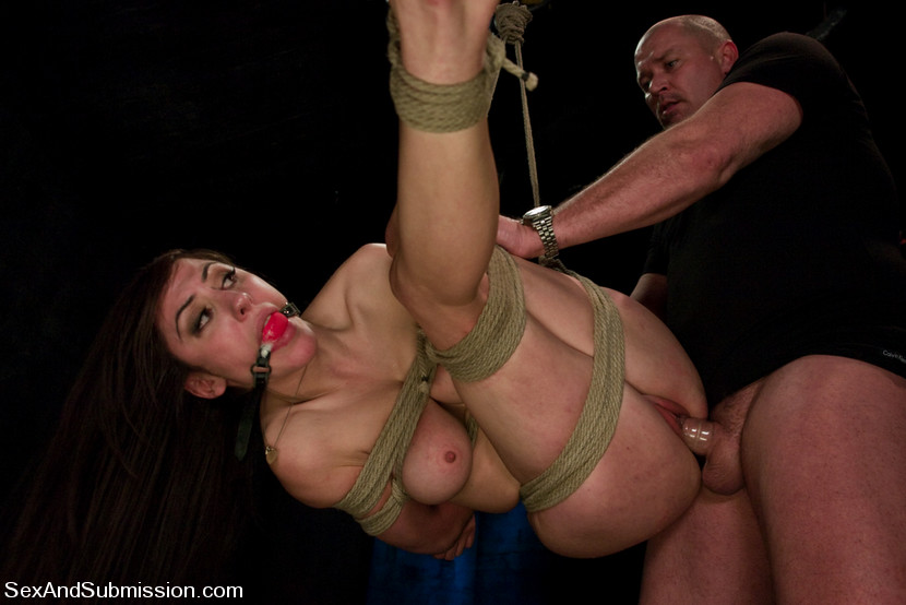 Image of Princess Donna tied with ropes, suspended and fucked in her pussy