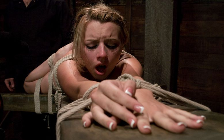 Closeup picture of Lexi Belle in bondage pain
