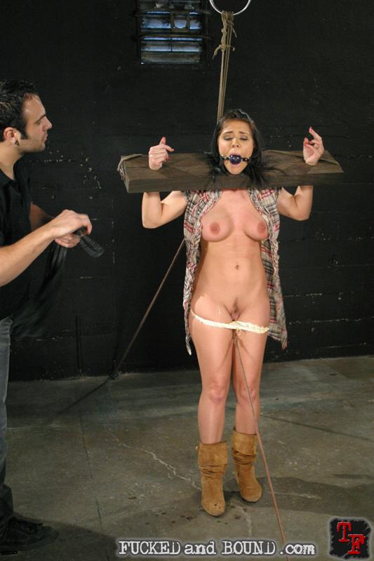 Photo fo a nude slave Beverly Hills put in wooden stocks