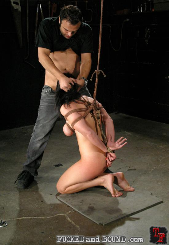 Image of tied slave Beverly Hills sucking cock