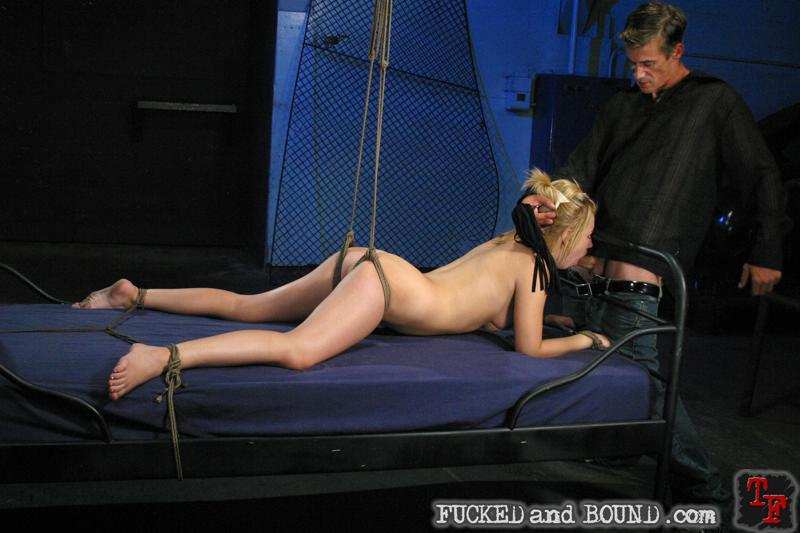Photo of bondage slave Lexi Belle sucking cock