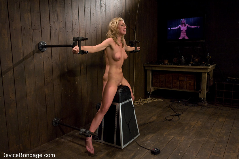 Pretty blonde tortured with machine fucking and wooden pony