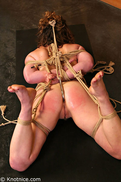 Rope bondage girl hogtied nude on the floor