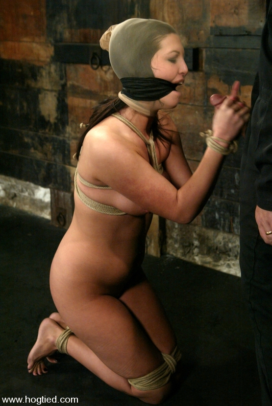 Enjoy helpless bondage girl doing a handjob