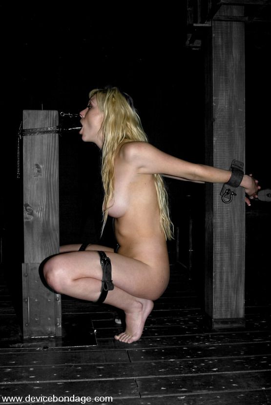Naked girl exposed in unusual bondage