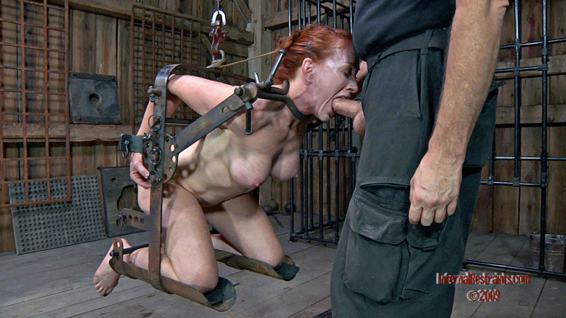 Cock sucking MILF slave put in BDSM rack