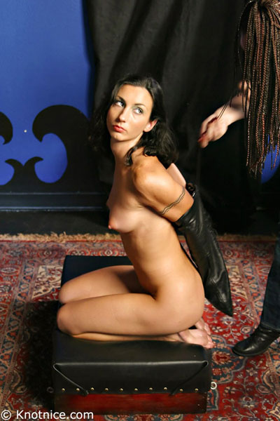 Naked armbinder slave posing on her knees