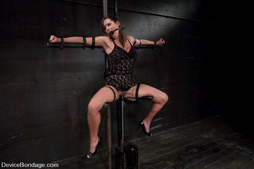 This tied spread eagle MILF slave looks very sexy