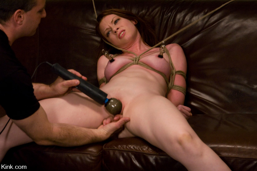 Bondage orgasm of a BDSM girl with nipple clamps