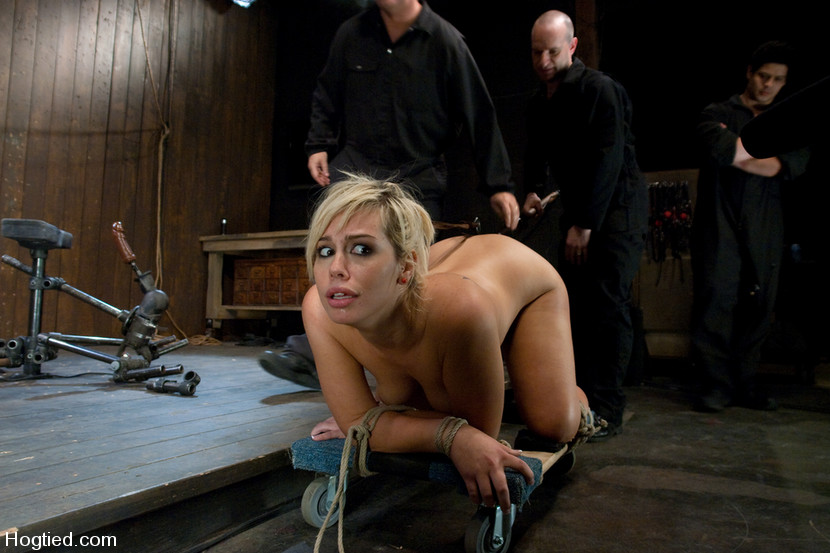 Sexy blonde nude and bound with ropes