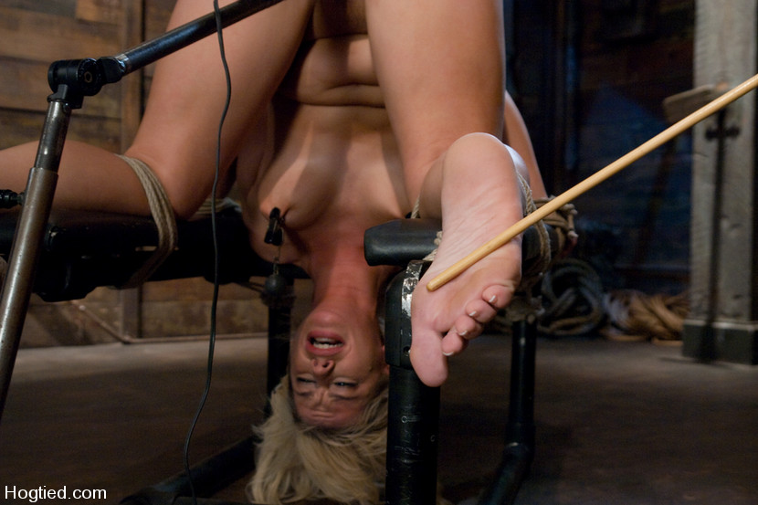 Tied blonde tormented with painful bastinado whipping