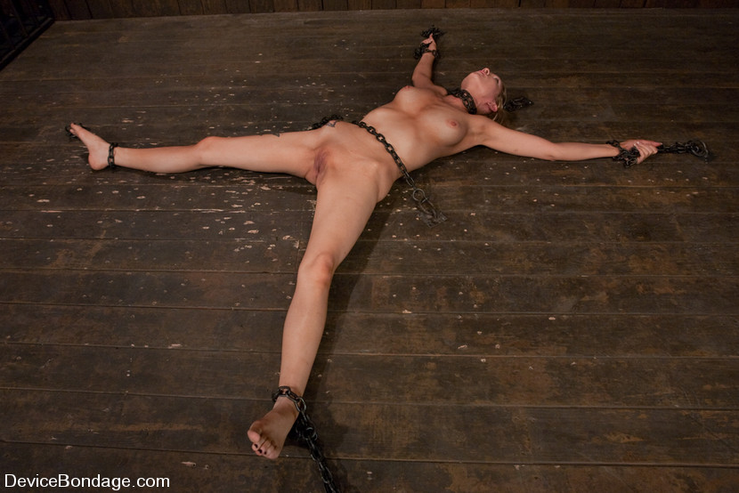 MILF slave restrained with heavy steel chains