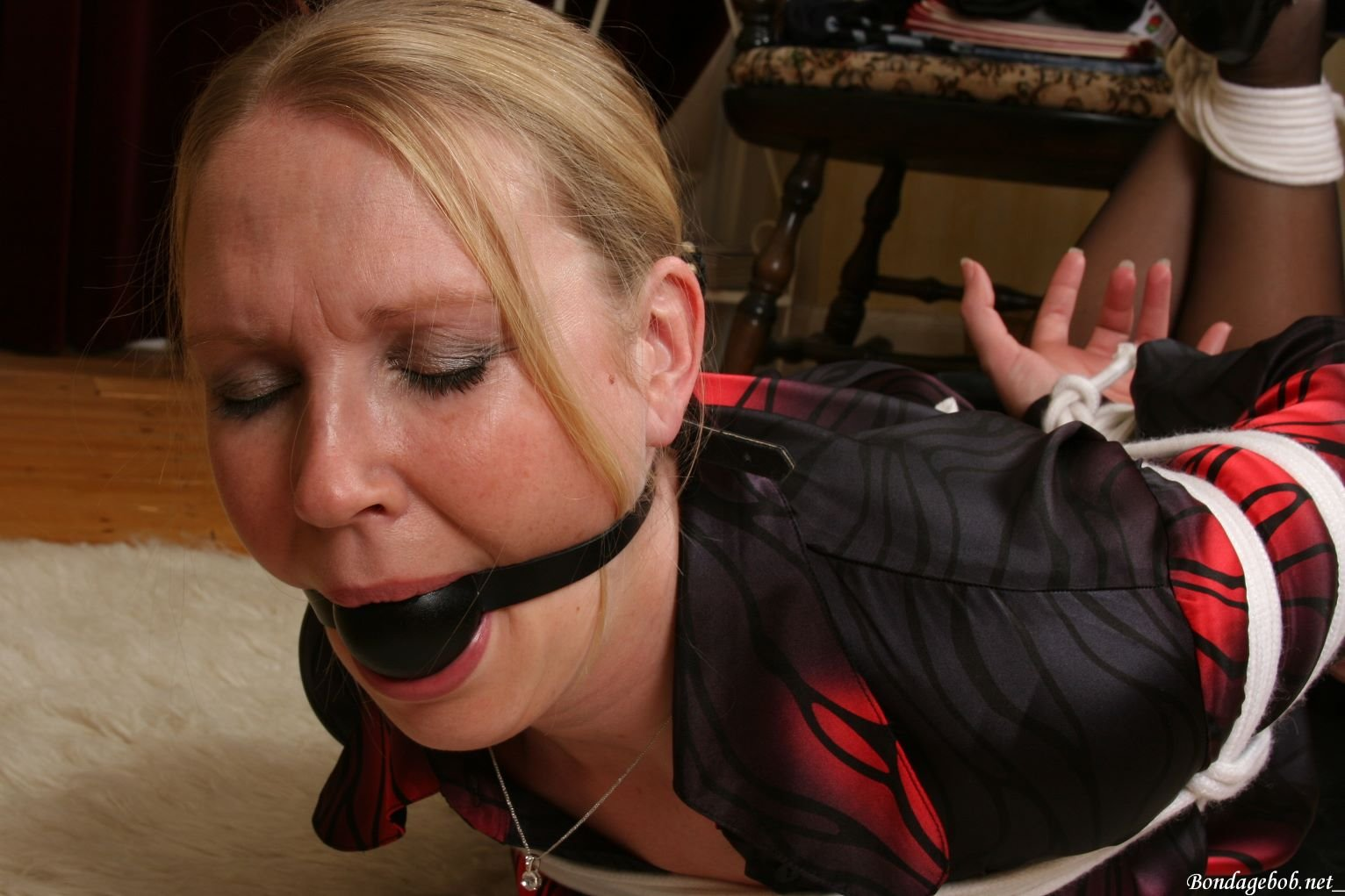 Imag of pretty middle-age woman ball gagged and bound