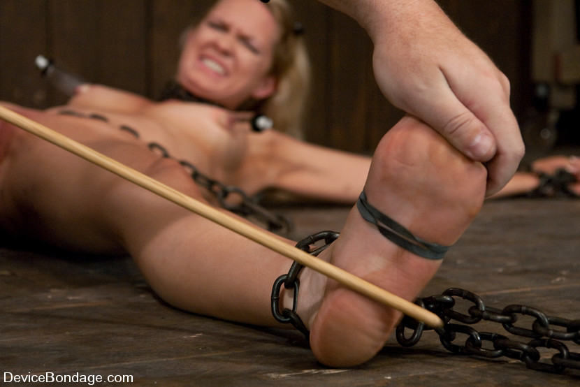 Helplessly bound woman feet whipping
