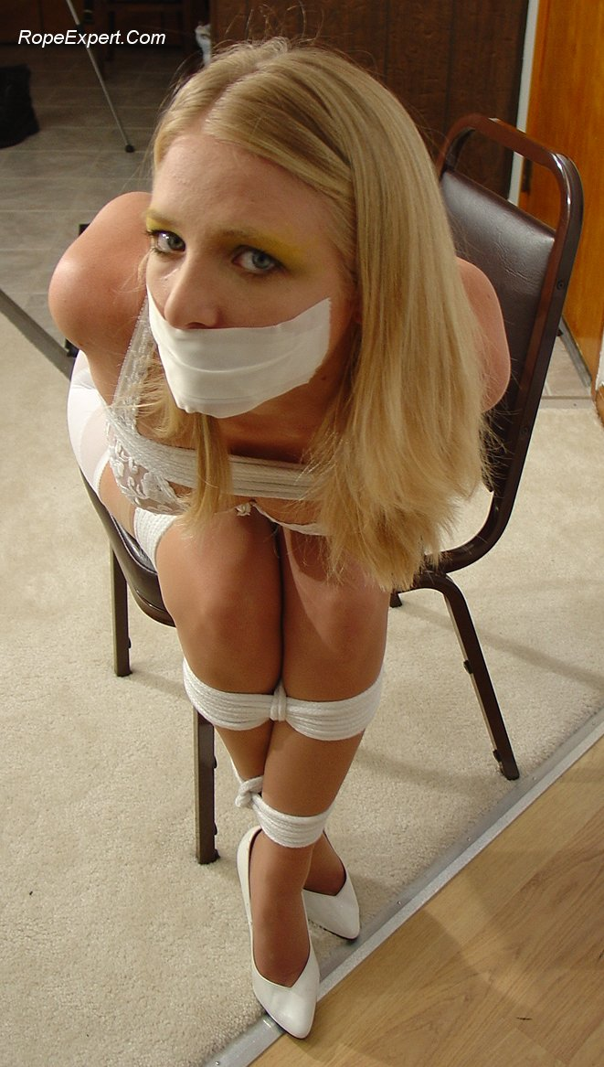 Lovely blonde secretary gagged and posing for the camera