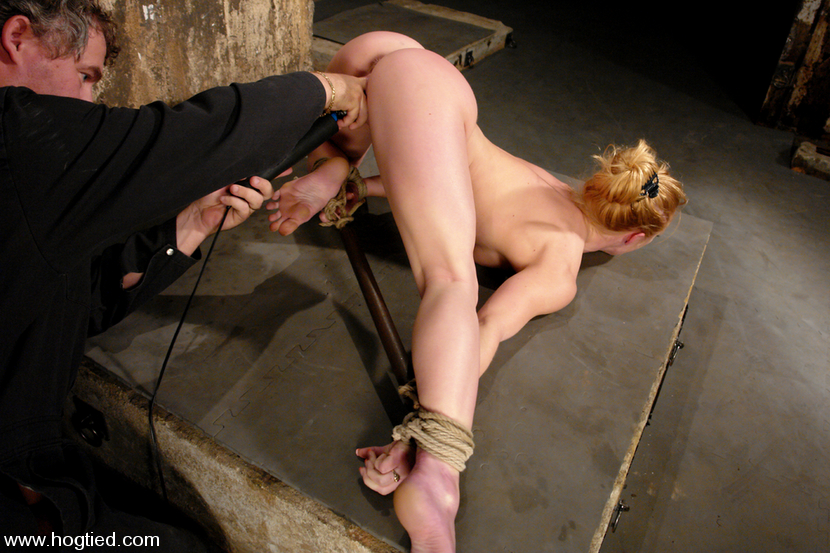 Nude female is prepared for bastinado whipping and fucked with finger