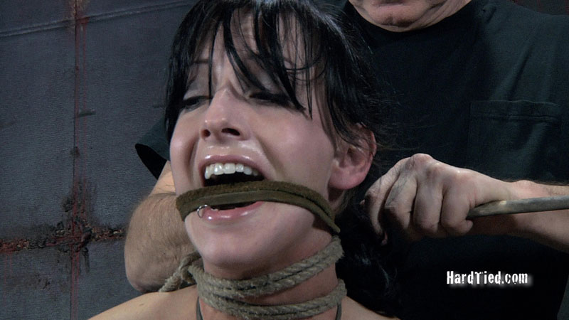 Bizarre BDSM gag is made from leather rope