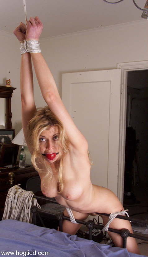 Pretty MILF slave looks really sexy in this bondage pose