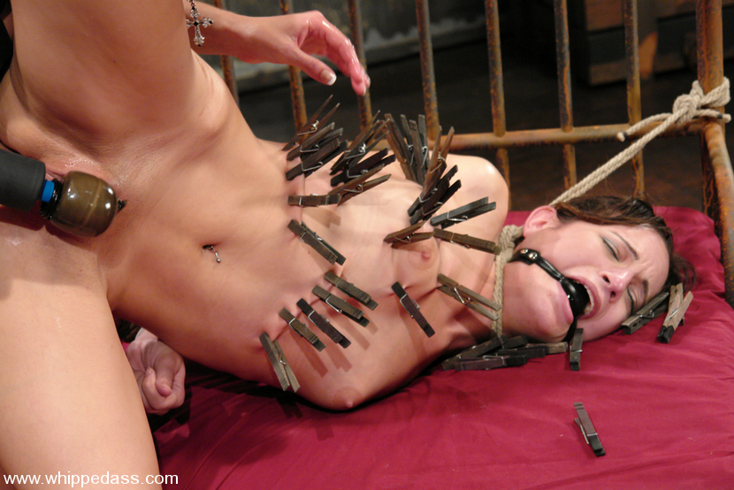 Painful BDSm torture for the gagged lesbian that is tied to bed