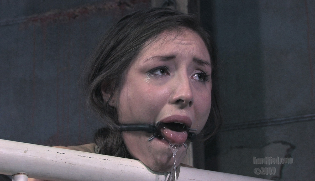 Loads of hot cum are leaking from the mouth of tied up woman