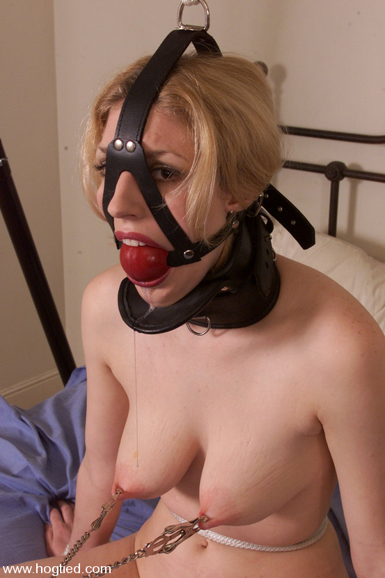 Helpless woman is gagged and posing with saliva dripping down from her mouth