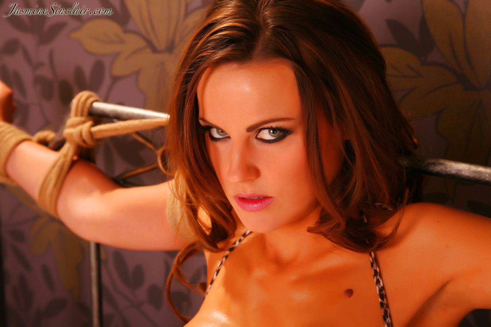 Beautiful Jasmine Sinclair enjoys every second of her bondage submission