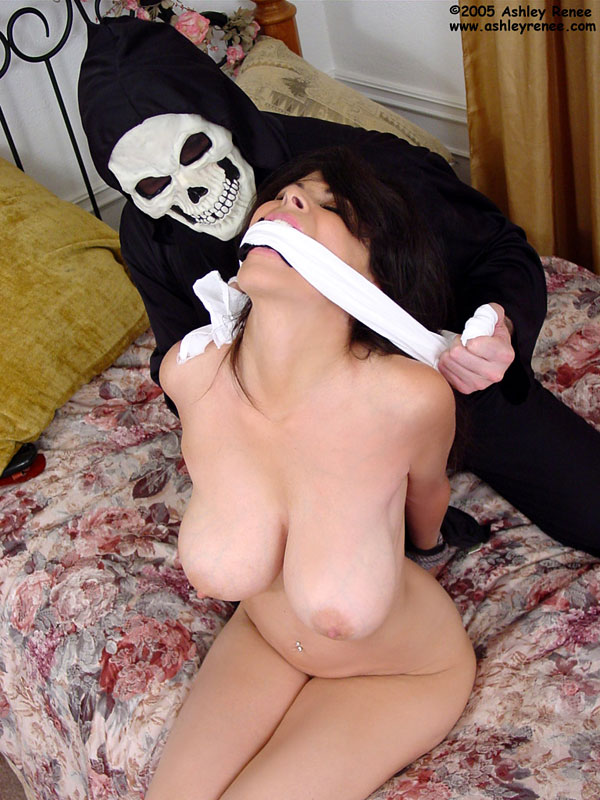 Busty MILF is having her mouth packed with clothe and than gagged with scarf