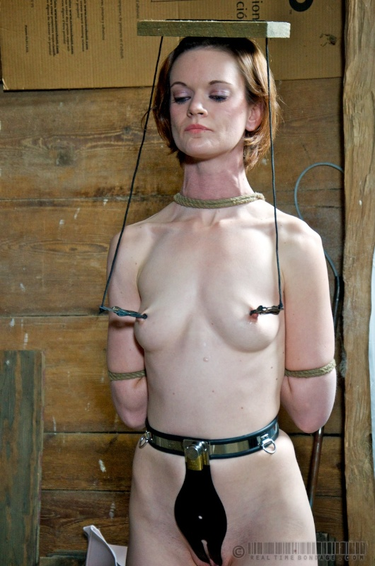 Nude woman is subjected to strict BDSM education