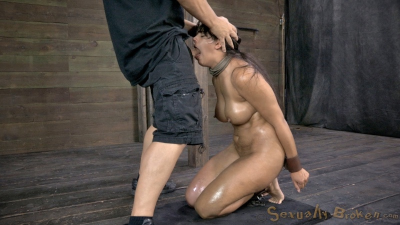 Kneeling MILF is handcuffed and blowing cock