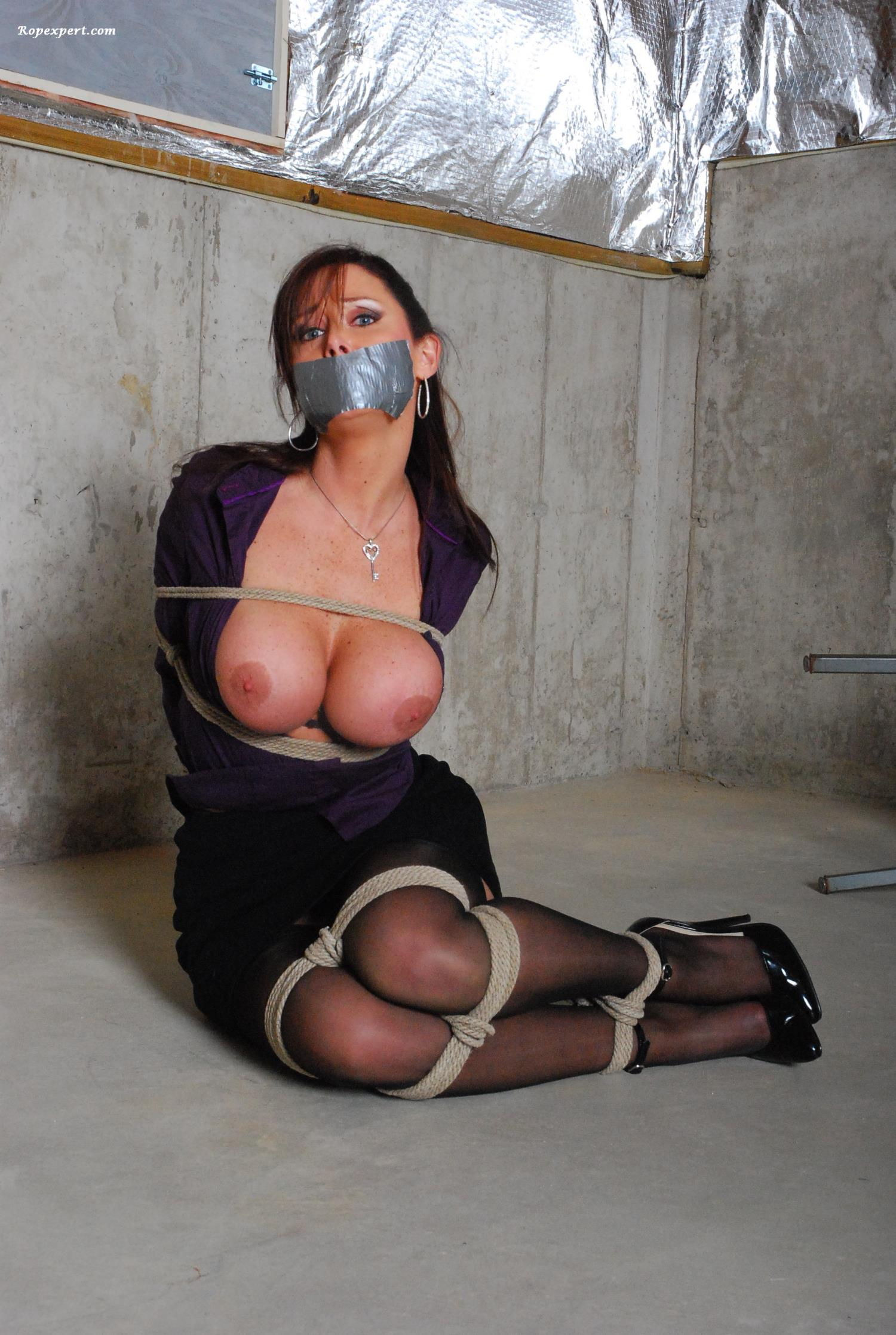 MILF is being abducted and posing in bondage with her boobs exposed