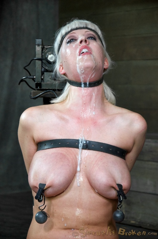 Bondage woman is having loads of cum all over her chest