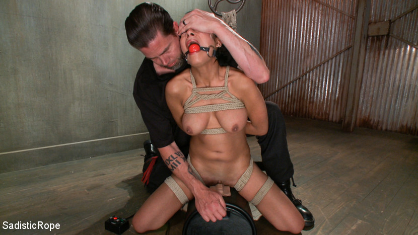 Master puts slave's clitor in close contact with the vibrating sex machine