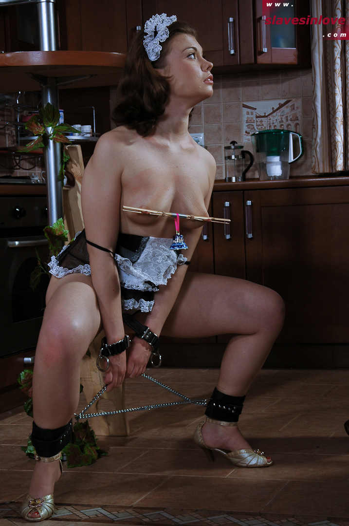 Young woman is chained and her nipples are clamped