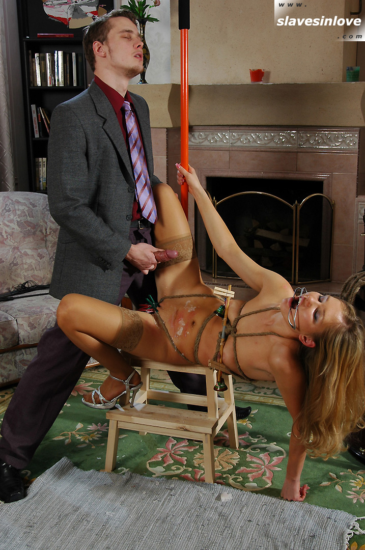 Master is spreading his cum all over bondage girl's belly