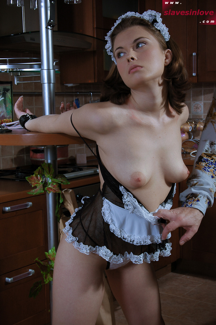 Slutty maid is handcuffed and her small tits are being exposed