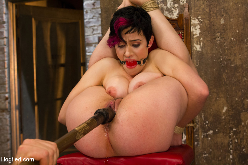 Helplessly bound woman is fucked with rubber dildo