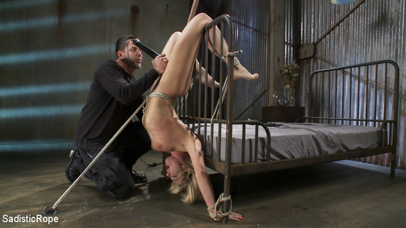 Tied up girl is having vibrator in close contact with her pussy