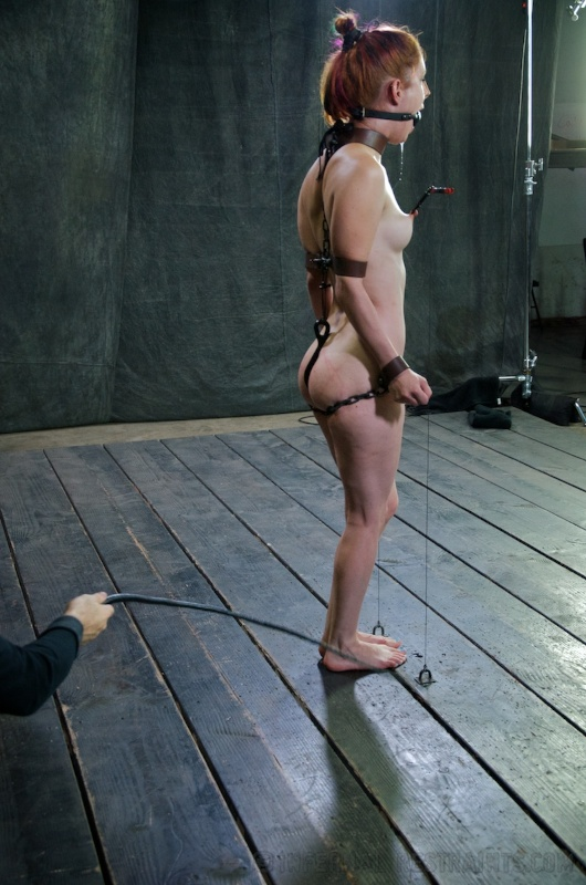 Nude woman is bound with kinky steel restraining device